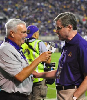 Brian Bailey interviews new ECU Chancellor Dr. Cecil Staton during a break in the action at Saturday night's game. (Bonesville Staff photo)