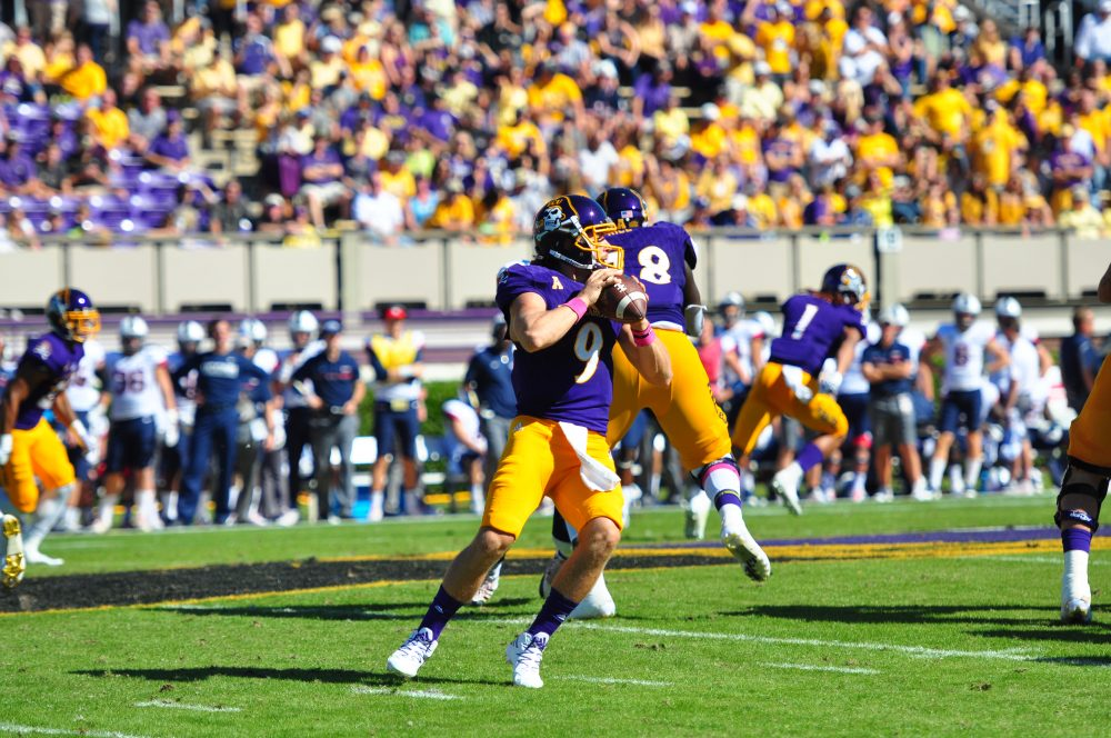 Quarterback Philip Nelson looks for an open receiver in the pocket. The senior threw for 253 yards and two touchdown and completed 29 of 41 attempts in a 41-3 win over UCONN (Bonesville Staff photo)