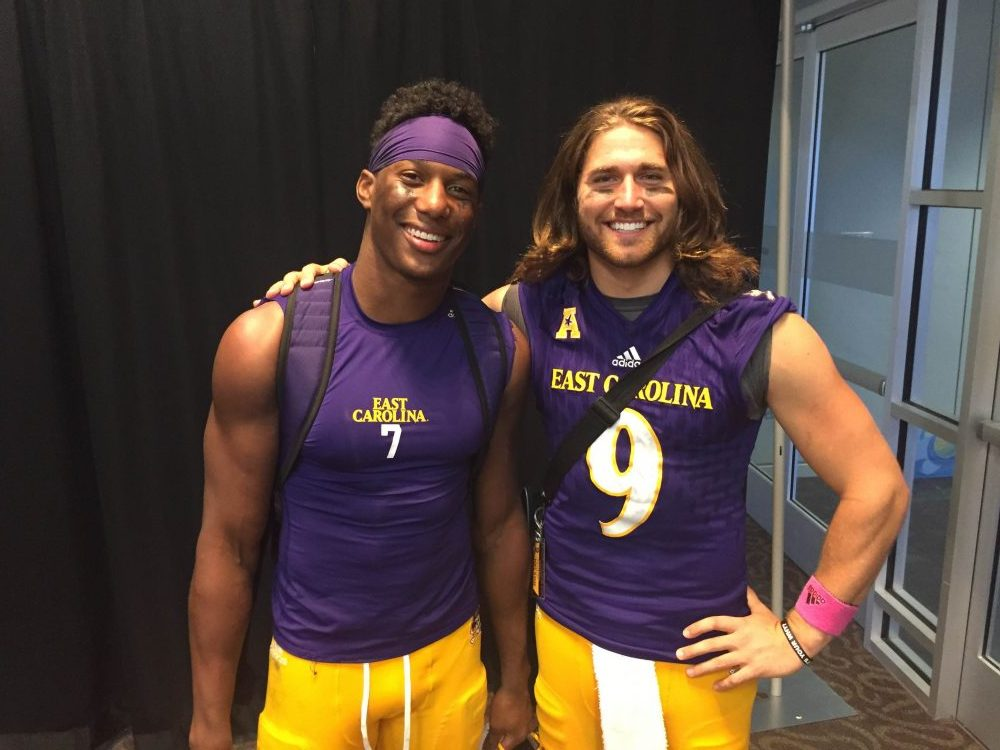 Zay Jones and Philip Nelson are all smiles after a homecoming win. Jones also moved to No. 2 on the FBS career receptions list on the day, second only to former teammate Justin Hardy. (Bonesville Staff photo)