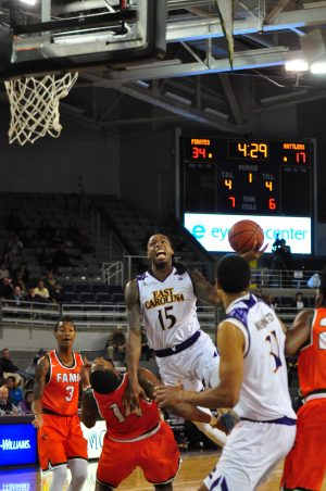 Kentrell Barkley draws a foul on a drive to the hoop. Barkley led the Pirates in scoring with 21 points. (Al Myatt photo)