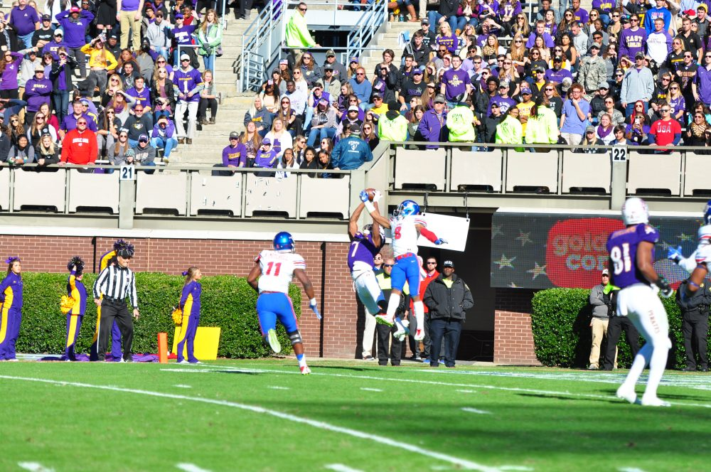 Zay Jones makes a leaping touchdown catch as time expires in the first half. (Bonesville Staff photo)