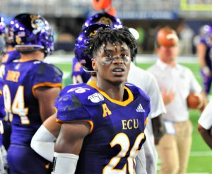 East Carolina defensive back Colby Gore checks out a replay on the big screen. (Photo by Al Myatt)