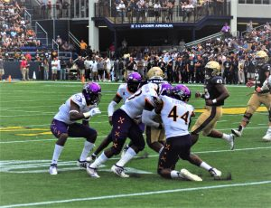 Navy's C.J. Williams runs into a host of Pirates in a 42-10 win for the Midshipmen