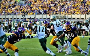 Tribe starting quarterback Hollis Mathis tried to squeeze between ECU defenders Xavier Smith (left) and Chance Purvis (46) (Photo by Al Myatt)