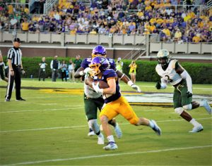 Tyler Snead runs for East Carolina after taking an inside pitch on Saturday night at Dowdy-Ficklen Stadium (Photo by Al Myatt)