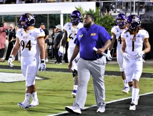 ECU captains come out before kickoff. From left are Alex Turner, D'Ante Smith, Kendall Futrell and Deondre Farrier (Al Myatt photo)