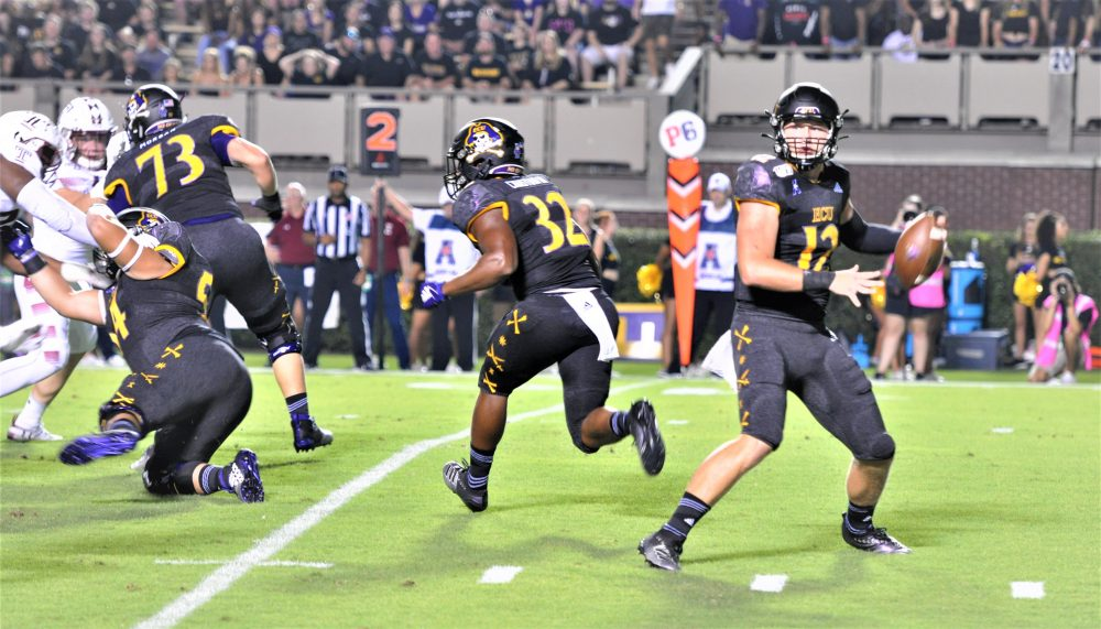 ECU sophomore quarterback Holton Ahlers sets to deliver a pass on Thursday night. (Photo by Al Myatt)