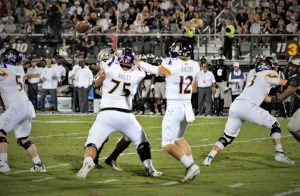 The Pirates protect Holton Ahlers as he throws a pass over the middle (Al Myatt photo)