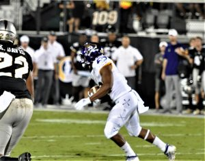 Trace Christian gets yards for ECU after catching a pass on Saturday night at UCF (Al Myatt photo)