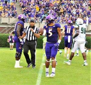 True freshman C.J. Johnson has the ball after a first-down reception for the Pirates. (Photo by Al Myatt)