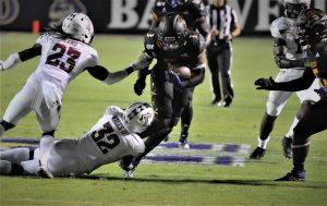 True freshman running back Demetrius Mauney gets some yards in the interior. (Photo by Al Myatt)