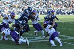 Jalen Price of the Pirates wraps up a UConn ball carrier. (Photo by Al Myatt)