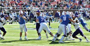 SMU quarterback Shane Buechele (7) gets pressure from the Pirates. (Photo by Al Myatt)