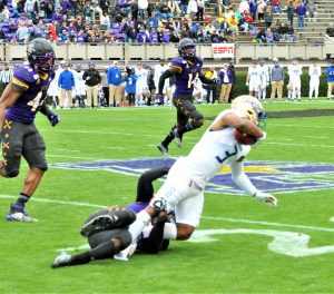 Safety Davondre 'Tank' Robinson tackles Tulsa standout Shamari Brooks (3). (Photo by Al Myatt)