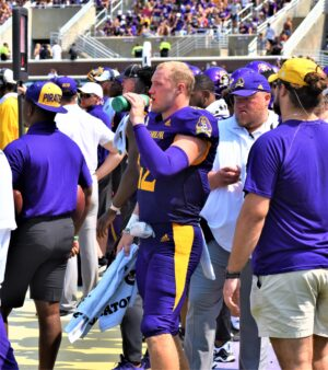 Holton Ahlers stays hydrated on a sunny Saturday at Dowdy-Ficklen Stadium.
